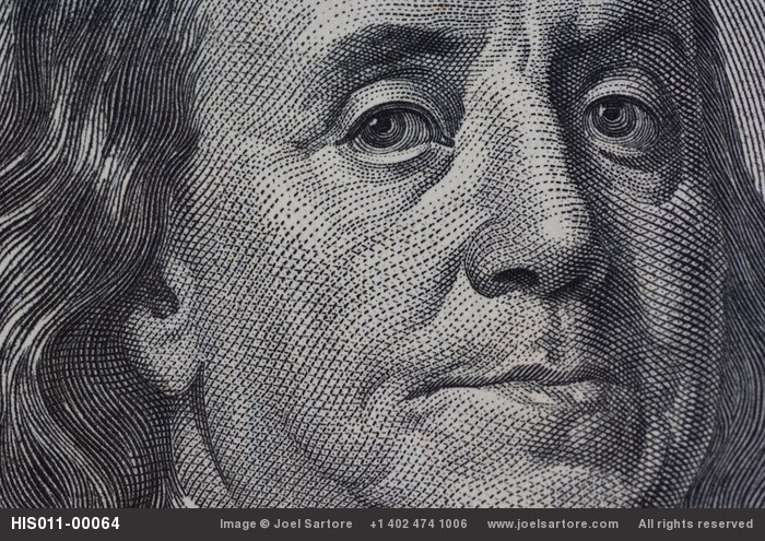 A close-up of a one hundred-dollar bill.